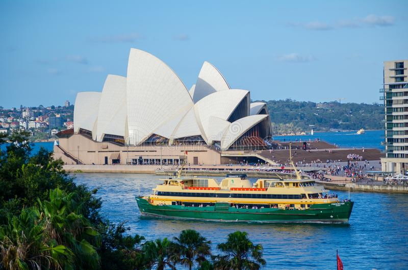 Green ferry boat in Sydney harbour with Opera house at the background. stock photography