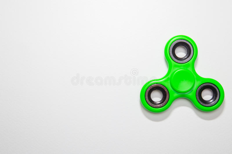 Green Fidget finger spinner toy image. Closeup stock images