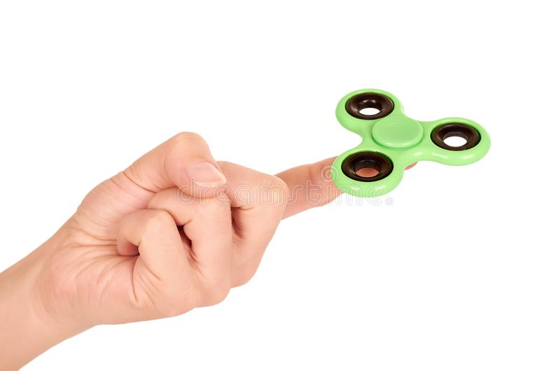 Green fidget spinner in hand isolated on white background stock image