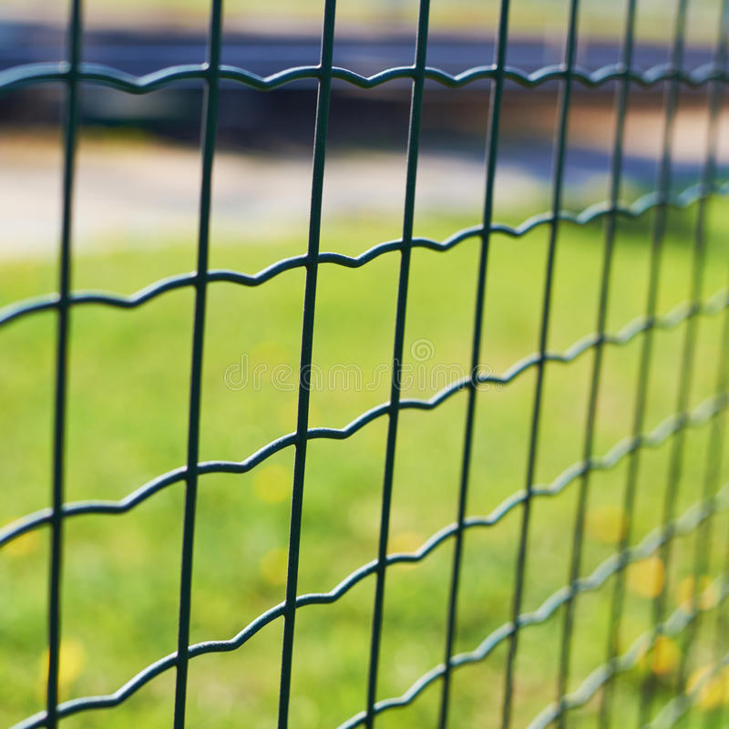 Free Green Field Behind The Fence Stock Photos - 44980383