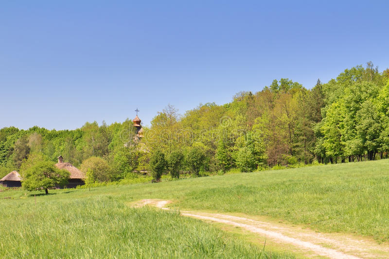 Download Green Field, Blue Sky And Old Wooden Chapel Royalty Free Stock Images - Image: 25456919