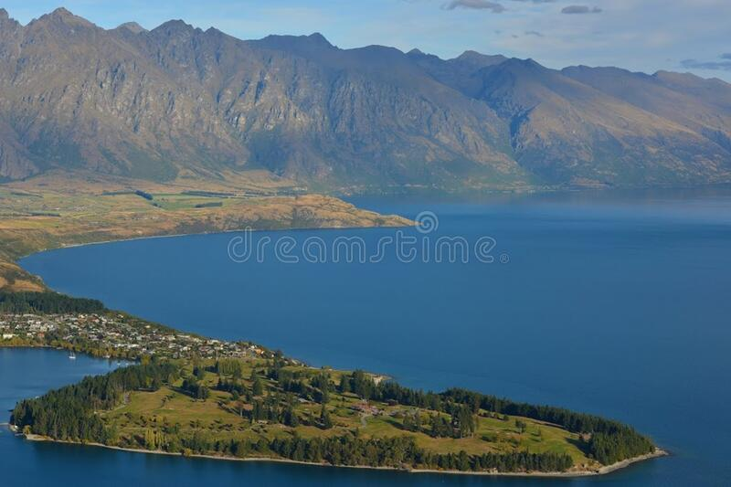 Green Field Island In The Middle Of Body Of Water Near Mountains During Daytime Free Public Domain Cc0 Image