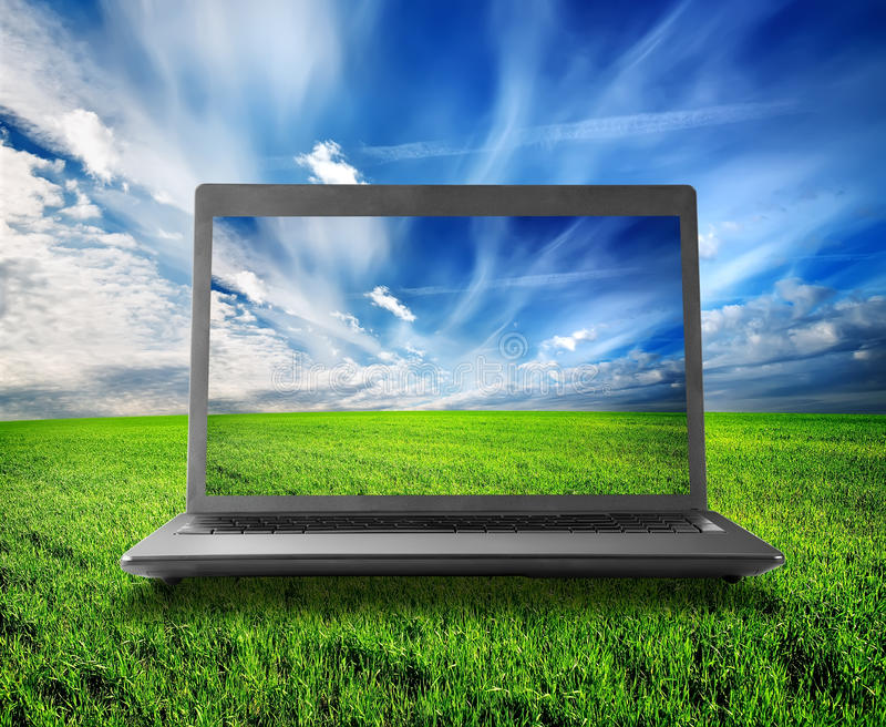 Green field and laptop royalty free stock photos