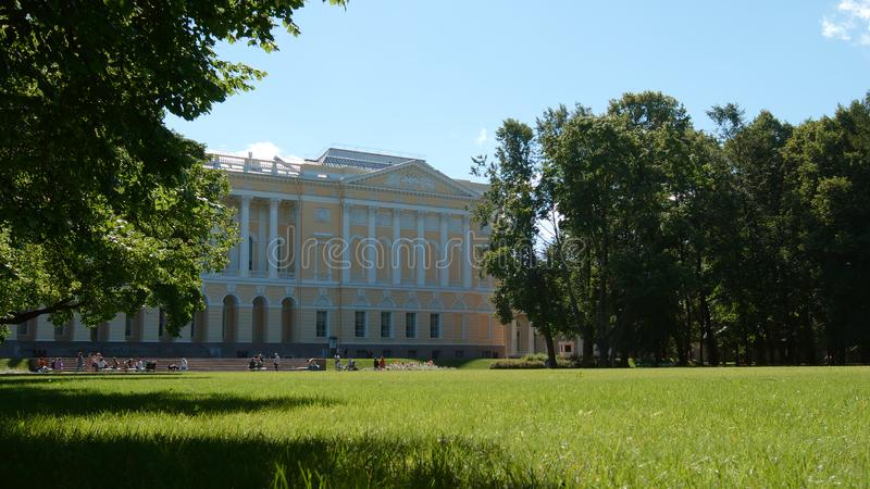 Green field in the Mikhailovsky Garden in the summer day - St. Petersburg, Russia royalty free stock image
