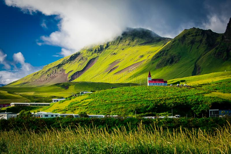 Green Field Near Mountain During Daytime royalty free stock photos