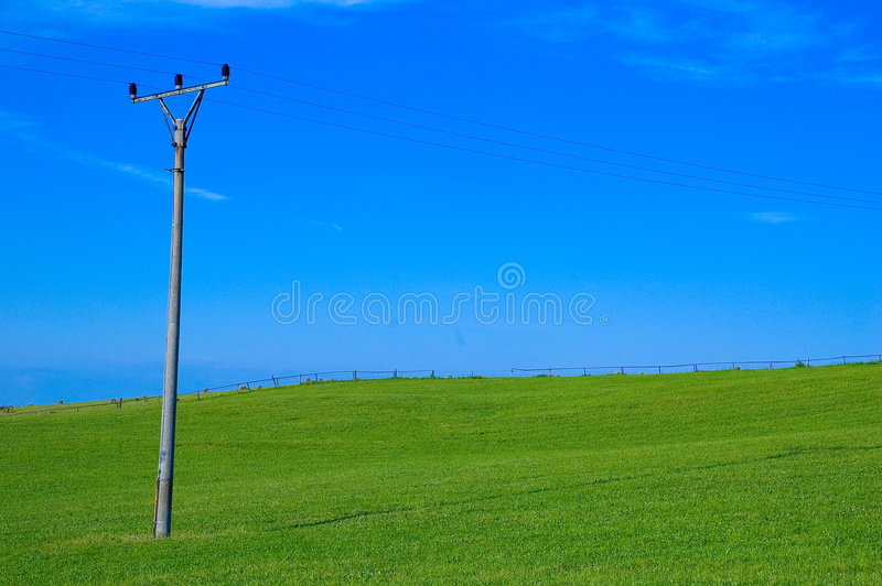 Download Green Field And Power Line Pole Royalty Free Stock Photography - Image: 245227
