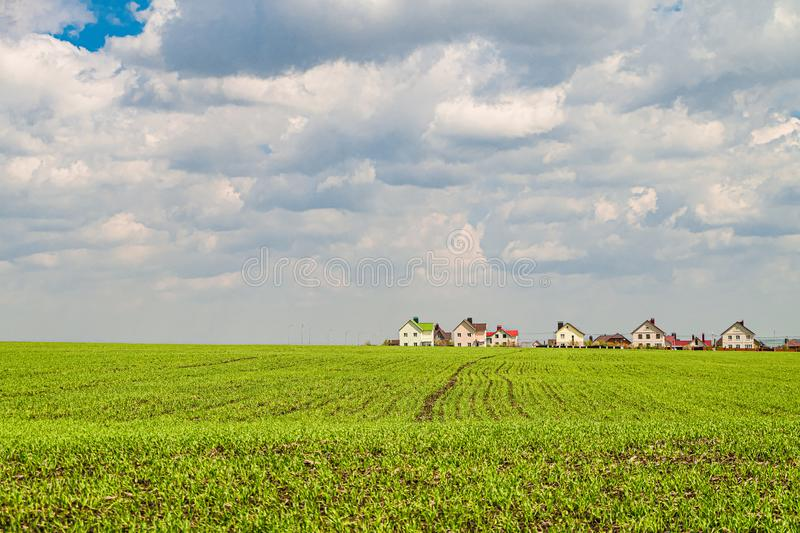 Green field slope and low rise individual housing residential neighborhood. Belgorod city, Southwest 2.1 district, Russia. Suburban landscape stock image