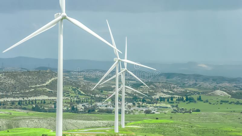 Green field with wind turbines, renewable energy source, nature conservation royalty free stock photo