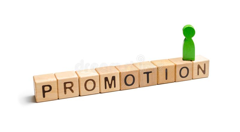 The green figure of a man standing on the dice with the words promotion. concept of success and improvement in work, the universal. Recognition of efficiency royalty free stock images