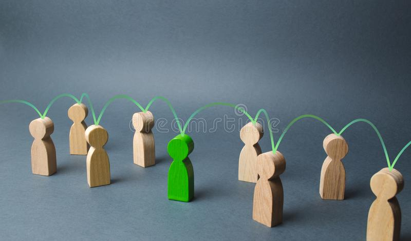 The green figure of a person unites other people around him. Social connections, communication. Organization. Call for cooperation royalty free stock image