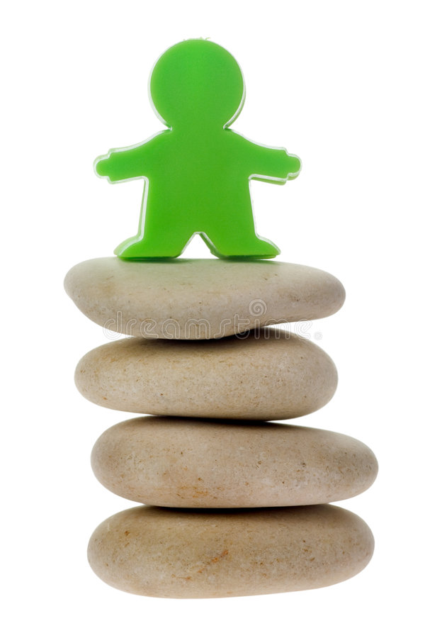 Download Green Figurine On A Stack Of Pebbles Stock Image - Image: 5700529