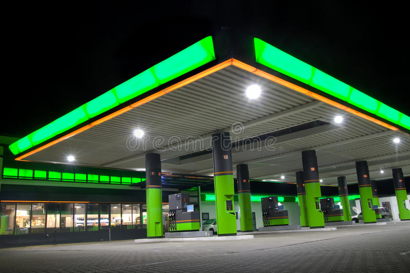 Green filling station stock images