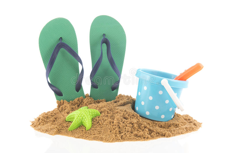 Green flip flops at the beach stock images