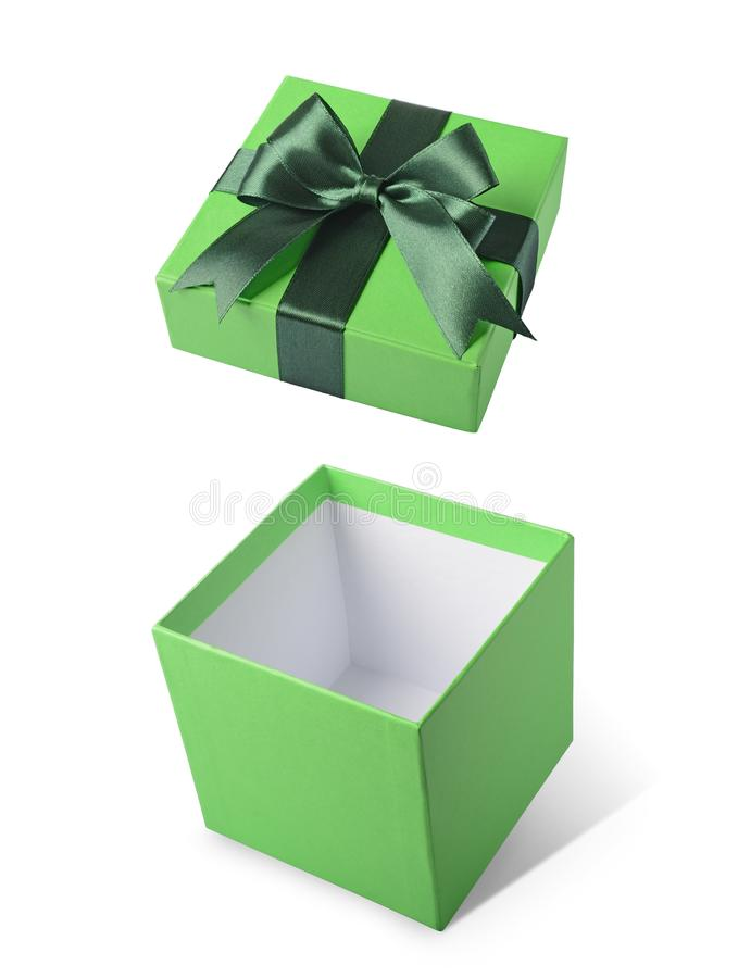 Green flying open gift box with satin bow stock images
