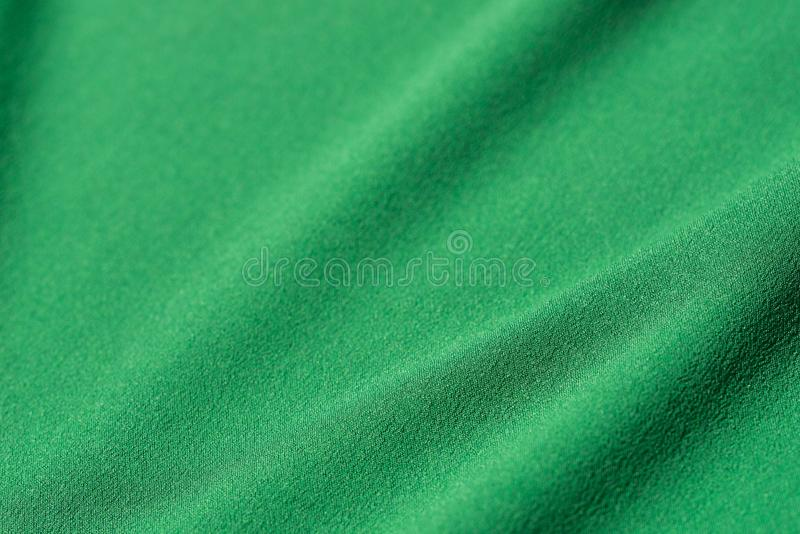 Green folded textile background royalty free stock photography