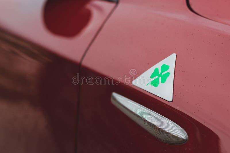 Green four leaf clover representing Alfa Romeo sport division. Green four leaf clover representing `quadrifoglio` in italian, sport division of Alfa Romeo cars royalty free stock photos