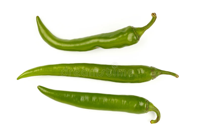 Green fresh jalapeno peppers close up on white. Three fresh long green jalapeno chili peppers isolated on white background, close up, elevated top view, directly stock images