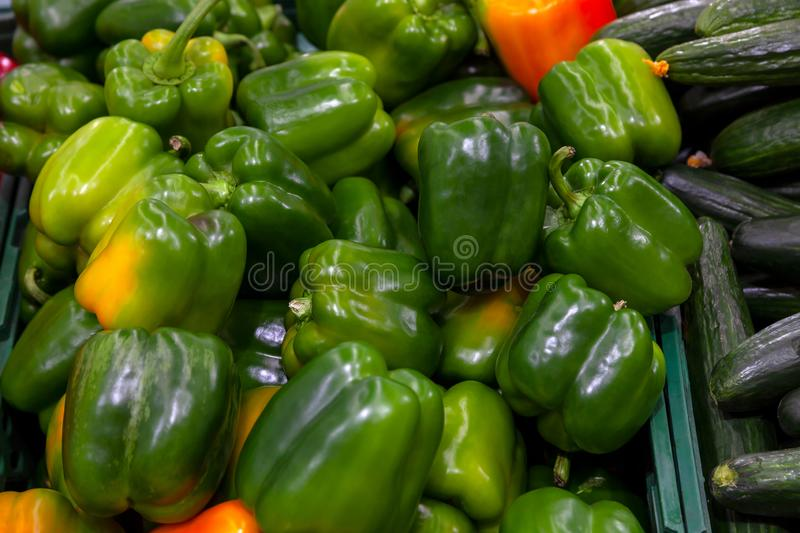 Green, fresh, juicy bell peppers with yellow specks on the sides stock photography