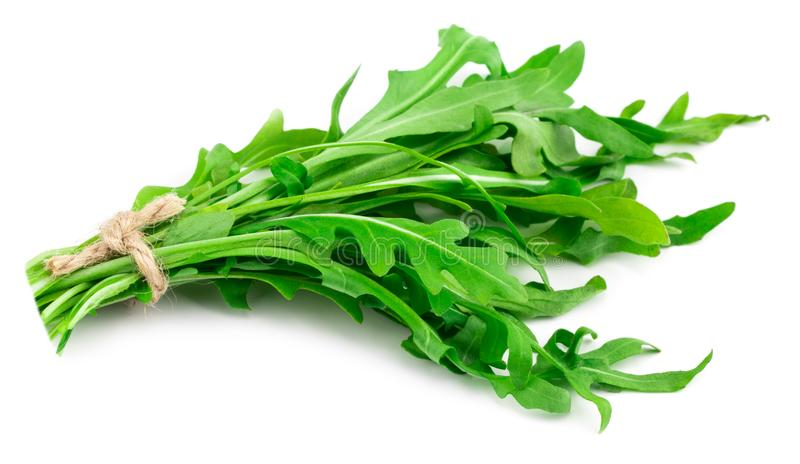 Green fresh rucola leaves isolated on white background. Rocket s. Alad or arugula royalty free stock image