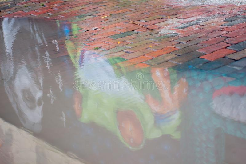 Green frog mural reflection royalty free stock photos