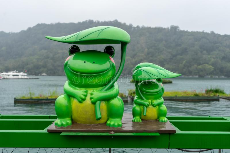 Green frog statue stock images
