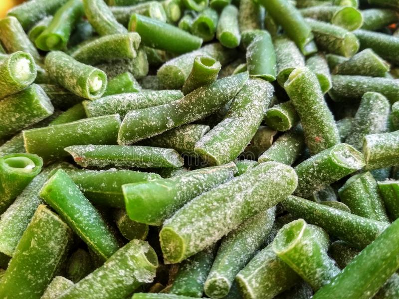 Green frozen beans. Closeup frozen cut green french bean, haricot vert. Vegetable food background, healthy vegetarian natural. Nutrition royalty free stock image