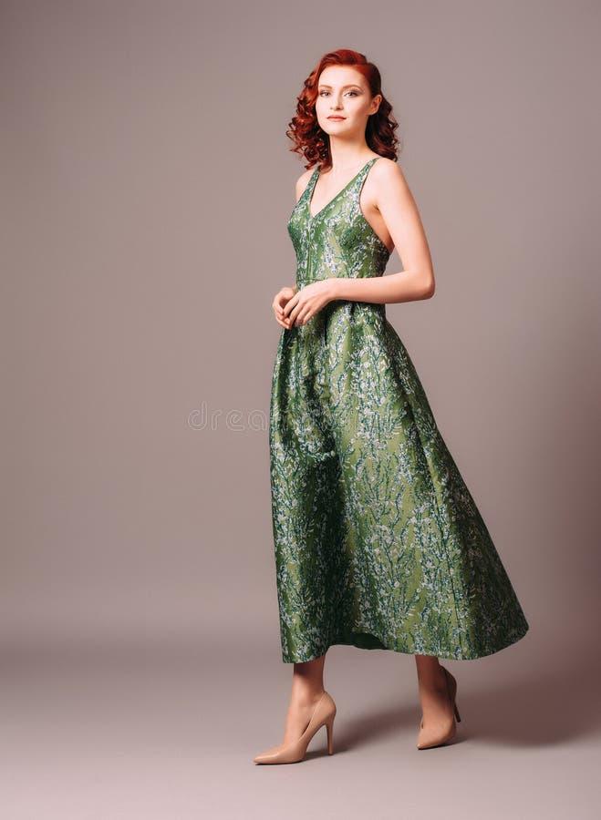 Free Green Full-length Evening Dress. Beautiful Model Wearing Emerald High Heels, Modern Feminine Look For An Event Stock Photos - 210019973