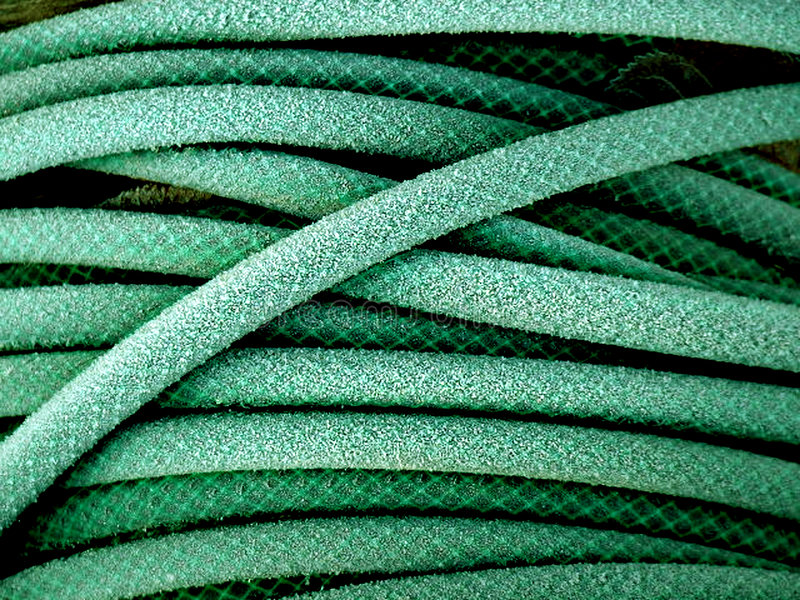 Green garden hose royalty free stock image