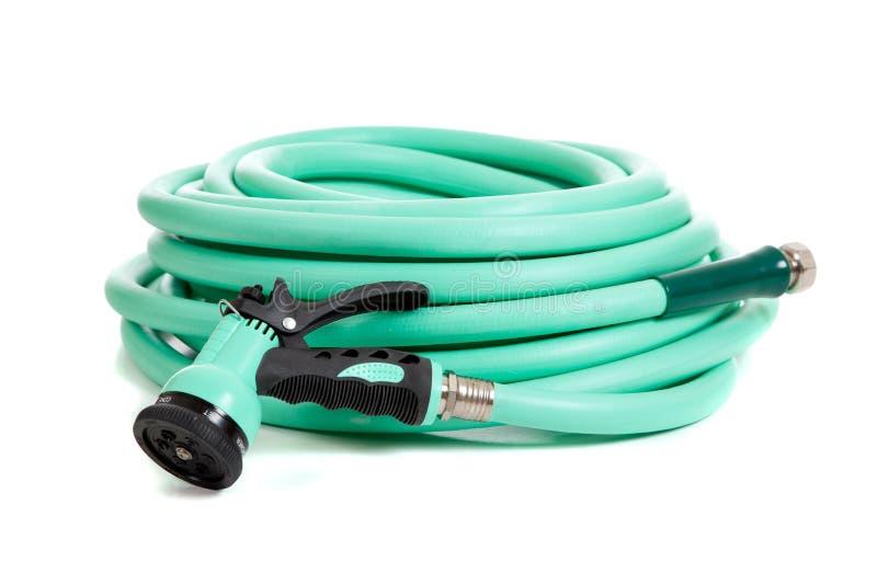 Green garden hose on a white background stock photos
