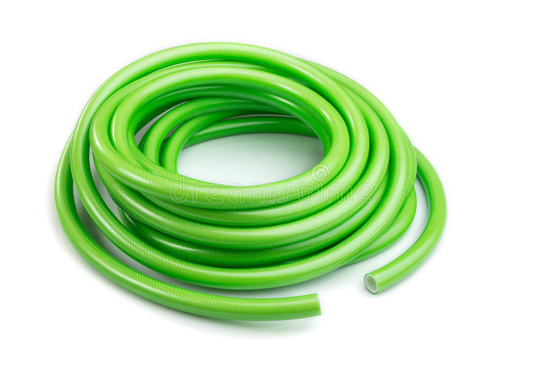 Green garden water hose isolated on white background royalty free stock images