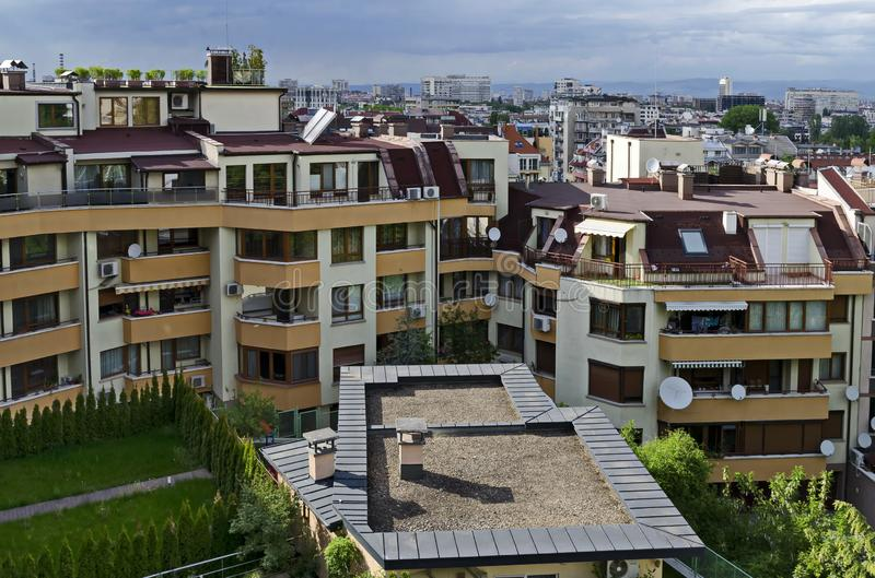 Green gardens with a place for recreation in a new residential neighborhood of the Bulgarian capital Sofia stock image