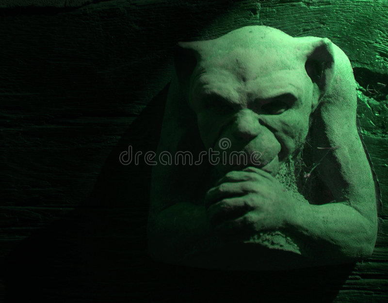 Green gargoyle stock photos