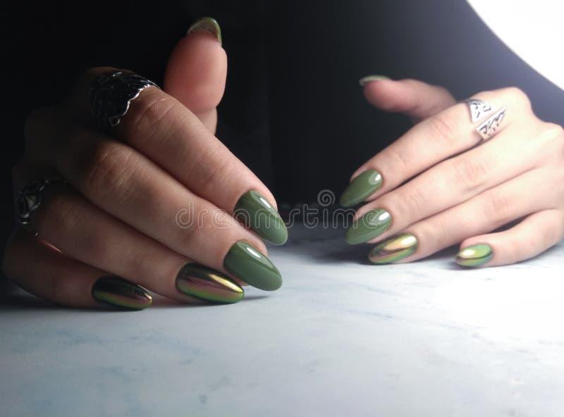 Green gel polish with iridescent cat eye royalty free stock image