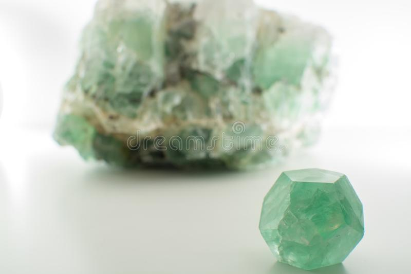 Green gemstone natural mineral fluoride or green beryl isolated royalty free stock images