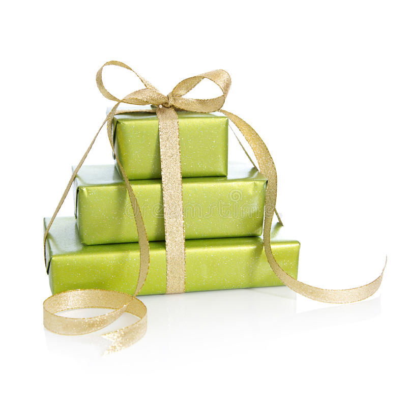 Green gift box isolated - wrapped in green paper with golden rib royalty free stock image