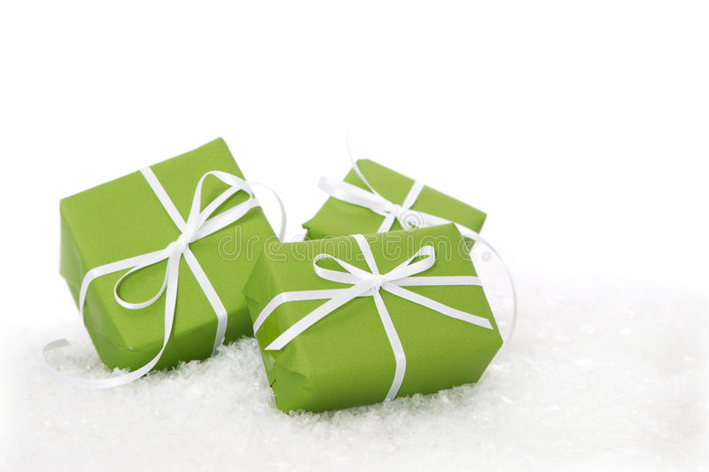 Green gift box tied with white ribbon - present isolated for christmas or birthday stock image