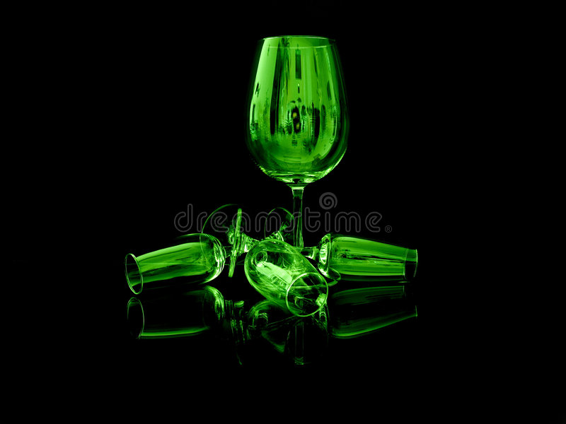 Green glass. On black background stock photos