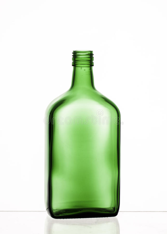 Green glass bottle. Transparent glass bottle with reflection royalty free stock image