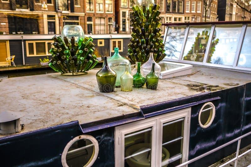 Green glass bottles as decorative element stock photo