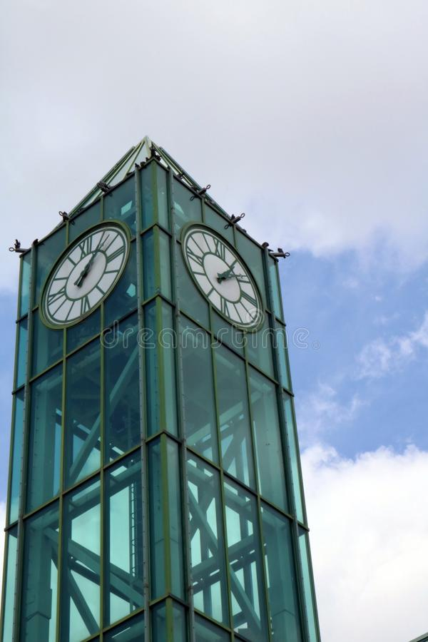 Green Glass Clock Tower in Downtown Kitchener. A view looking up at the green transparent clock tower in Kitchener, Ontario, Canada stock image