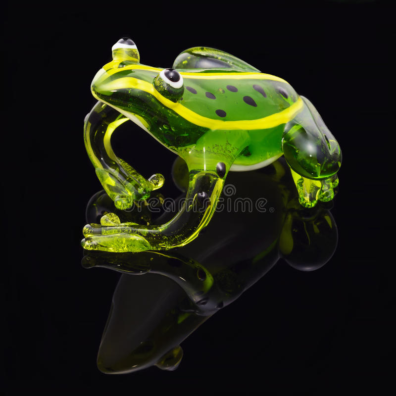 Green glass frog on black royalty free stock photo