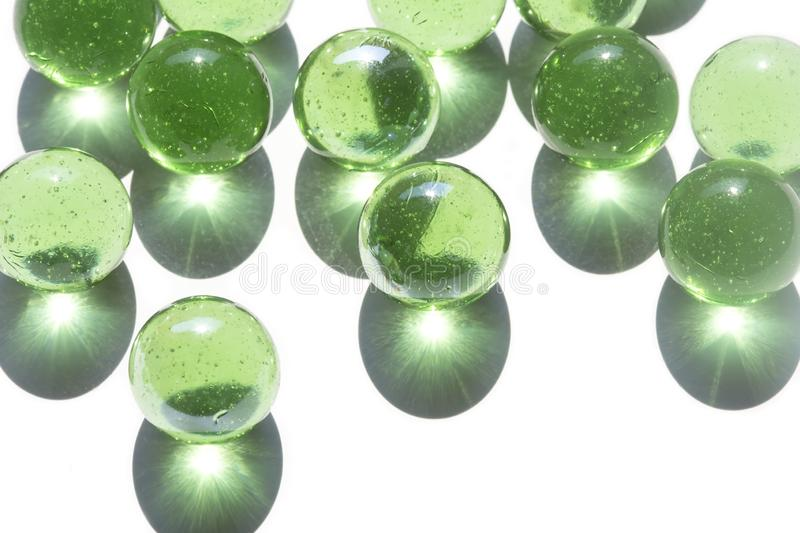 Green glass marbles stock photography