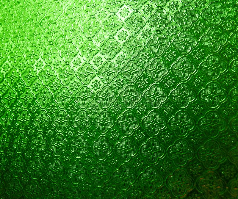 Green glass pattern on wall with lighting .Decoration for background and pattern concept royalty free stock photography