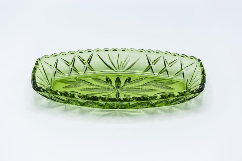 Green glass relish tray or candy dish. A green glass relish tray or candy dish stock photo