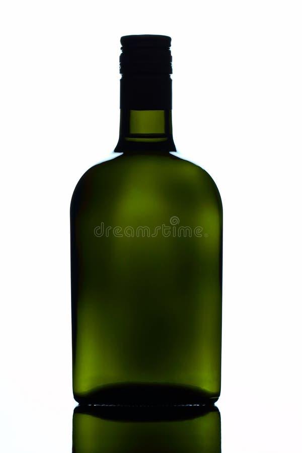 Green glass square bottle stock photo