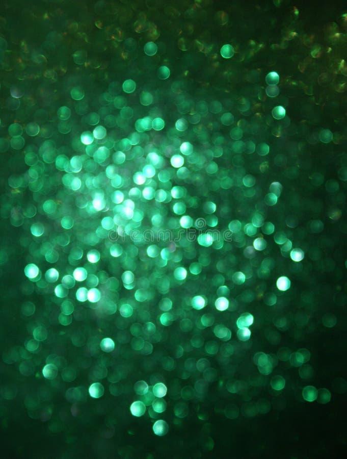 Green Glittery Blur Background. Green glittery blurred background, resembles sequins
