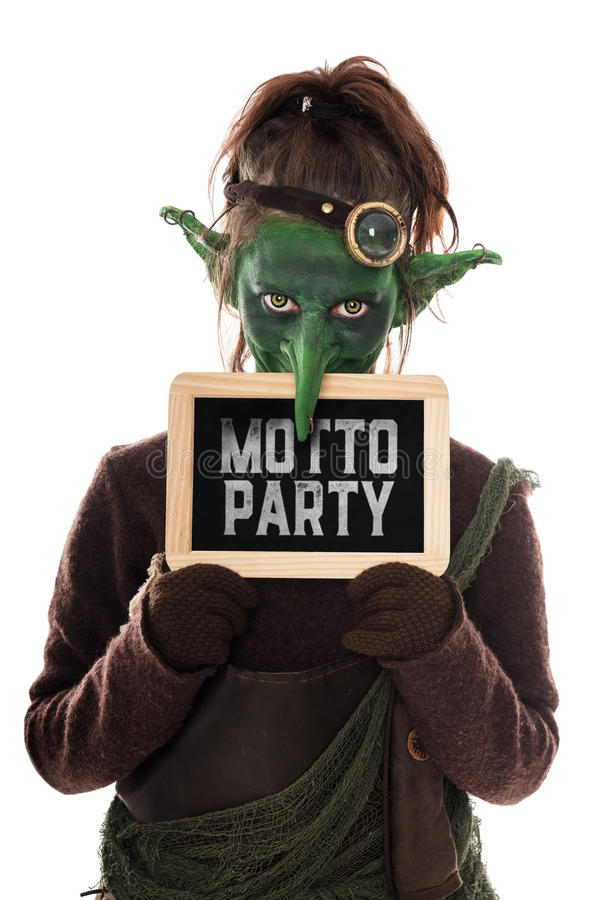 Green Goblin holding a slat with german text, theme party. Green Goblin holding a slat with german text motto party, which means theme party stock photos