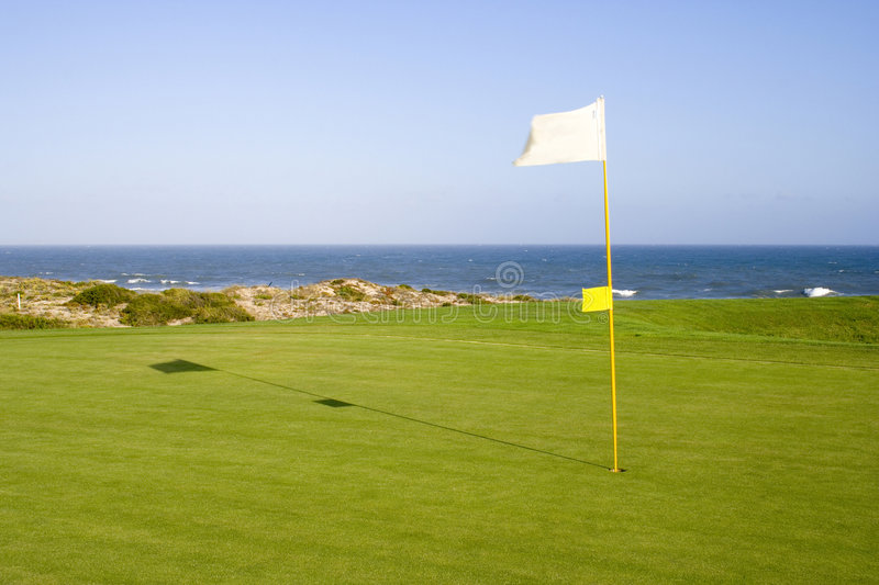 Green in a golf course stock photography
