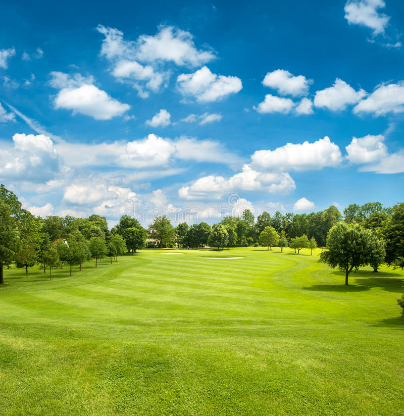 Download Green Golf Field And Blue Cloudy Sky Stock Images - Image: 31765624