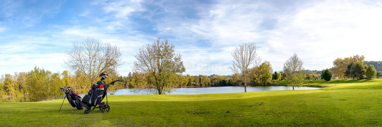 Green golf field and blue cloudy sky. A green golf field and blue cloudy sky stock photo